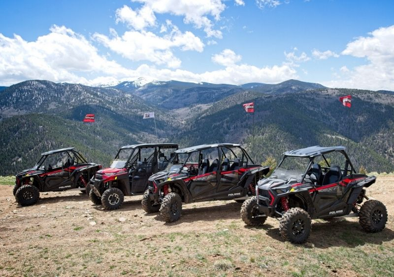 Polaris-RZRs-and-RANGER-parked-along-a-scenic-mountainview-lookout