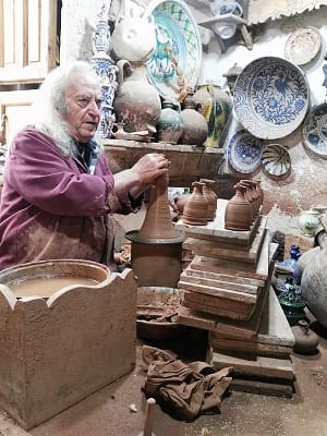 Tito at his potters wheel in the museum shop in Ubeda, Spain