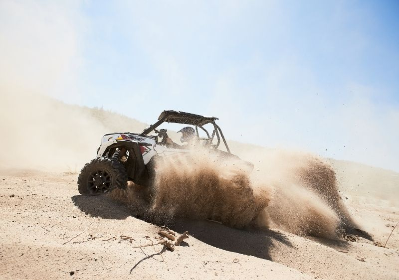 off-road vehicle driving through sand