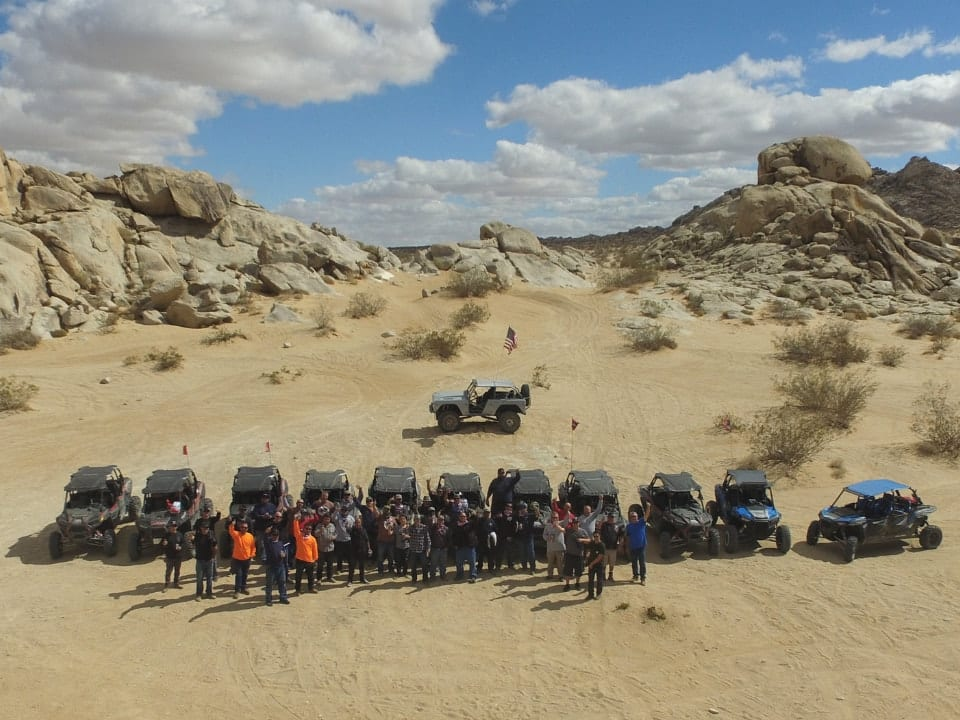 group of guests off-road vehicles in desert