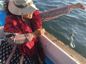 That's my mom with her newly caught fish. Yay!