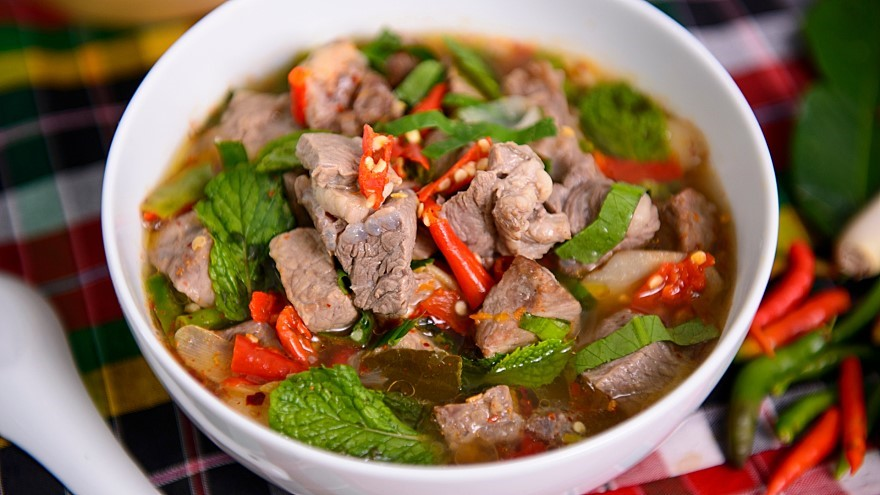 Spicy beef soup with herbs