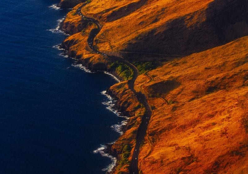 aerial view of a winding road along the Maui coast