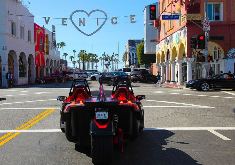 Polaris-Slingshot-driving-through-Venice-California