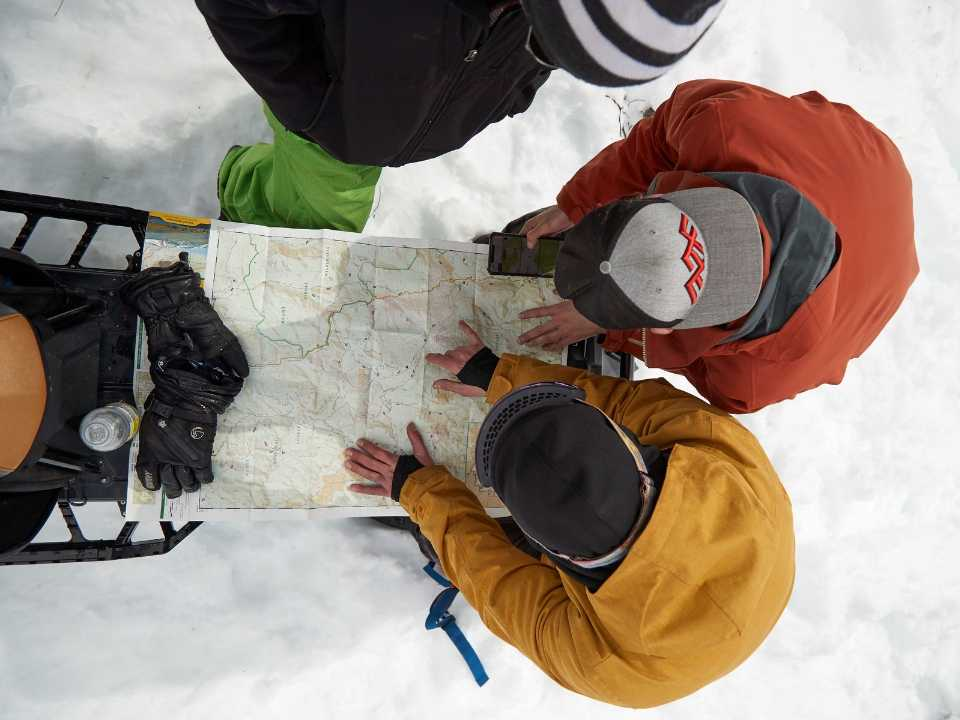 guests looking at trail map