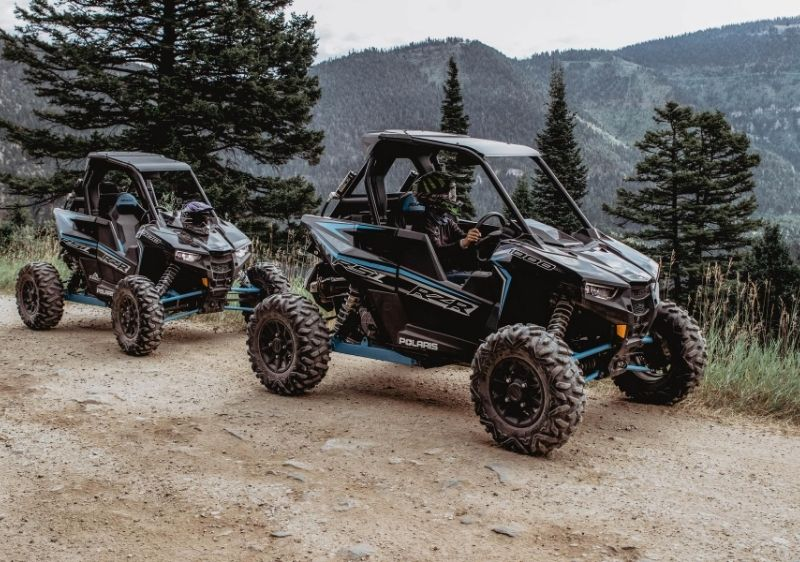 Polaris-RZRs-parked-near-a-scenic-overlook