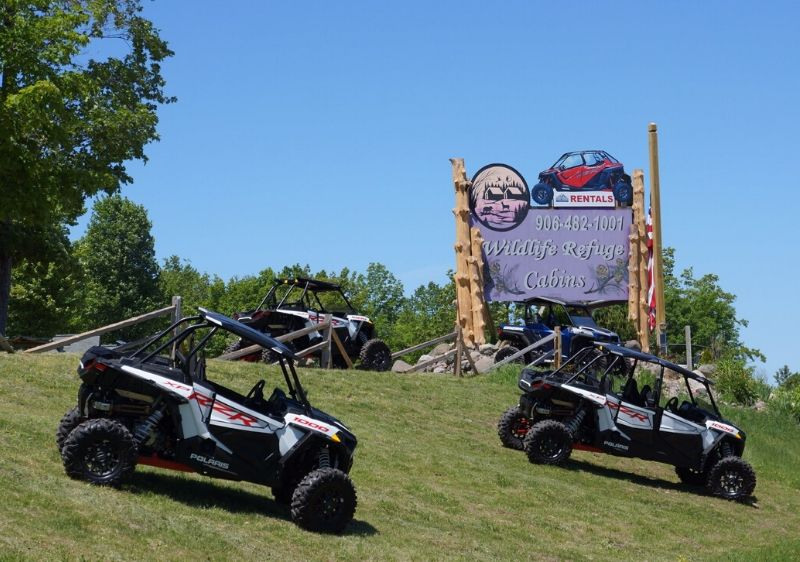 Polaris-RZRs-parked-outfront-Wildlife-Refuge-Cabins