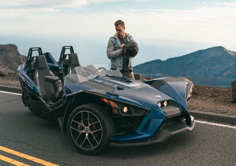 guest gearing up to drive a Polaris Slingshot