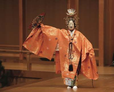A scene from the Uzawas' noh performance.