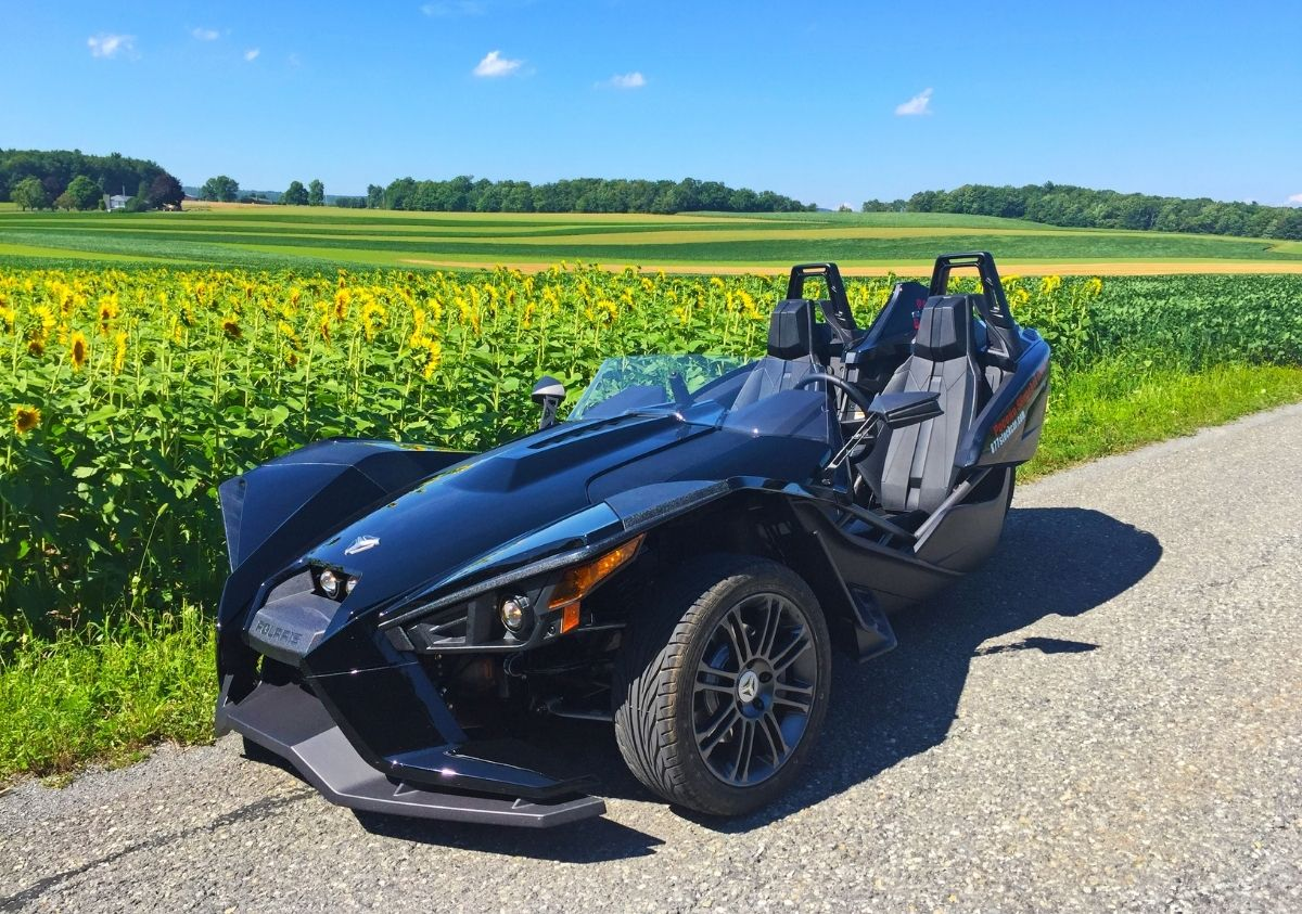 Polaris-Slingshot-near-a-sunflower-field