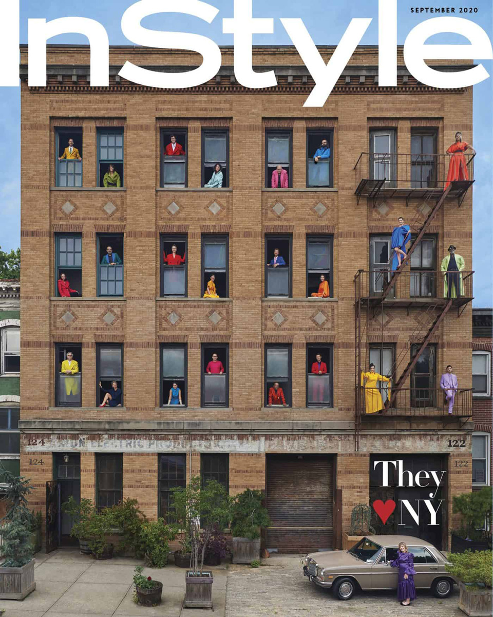 Cover of InStyle magazine with a photo of colorfully dressed artists in the windows of a Brooklyn building