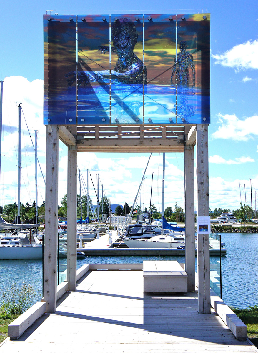 Glass panels painted with abstract figures emerging from the sea, installed above a pier leading to a marina docked with sailboats