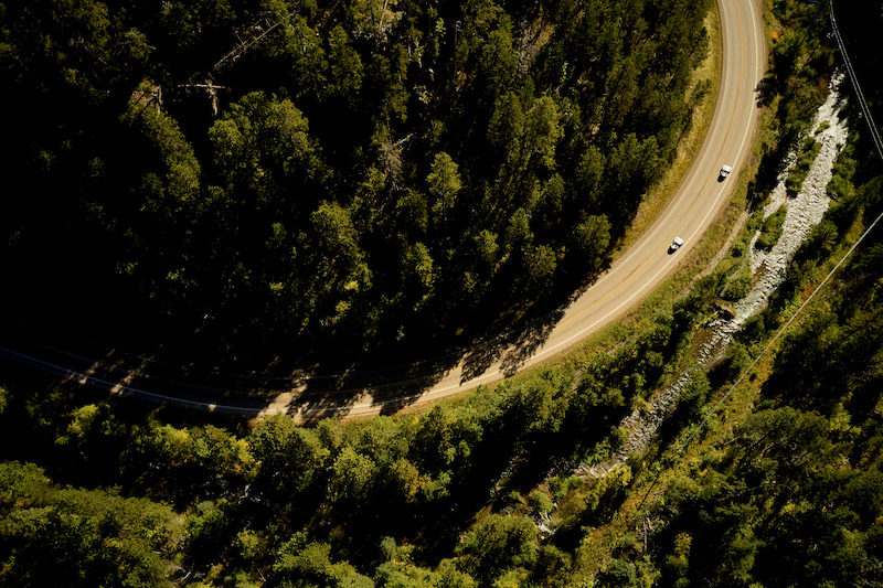 Aerial-view-of-Slingshots-on-a-curving-road