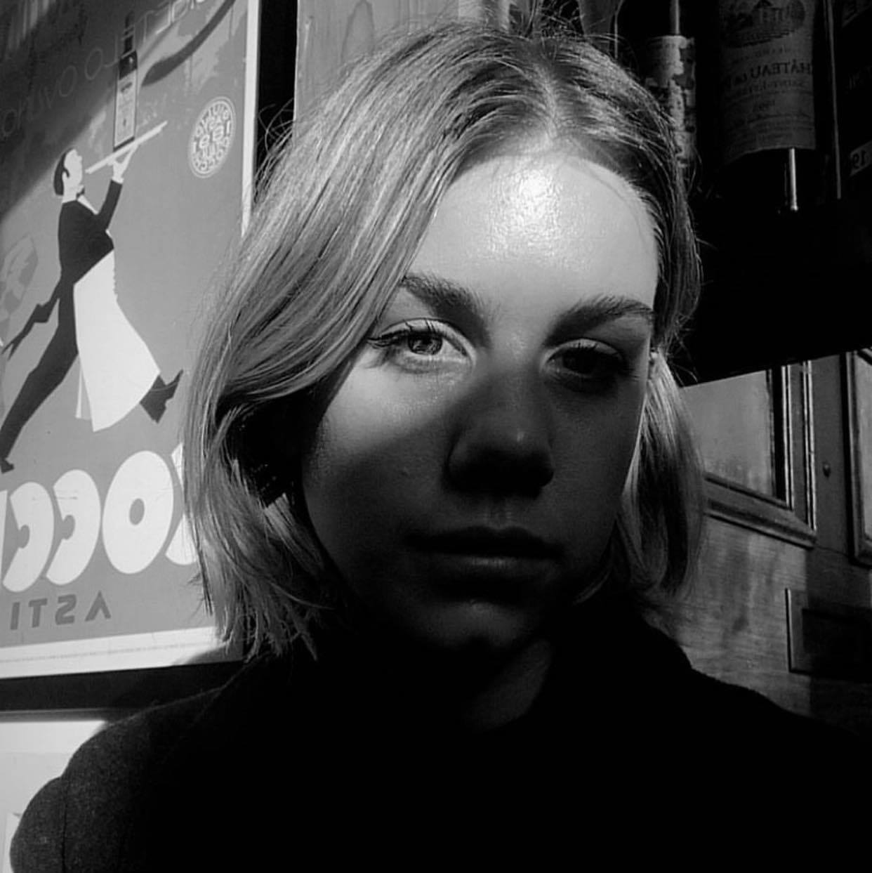 A black and white image of a person's face