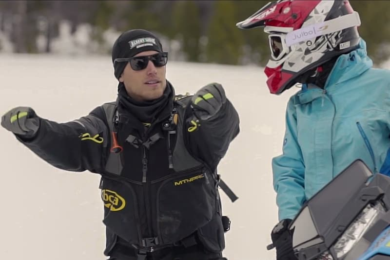 Snowmobile guide training guests
