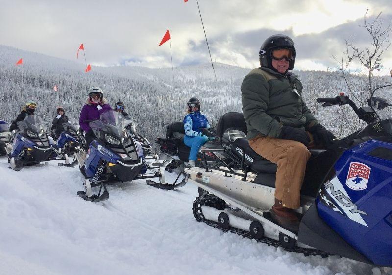 group of snowmboilers parked at scenic overlook
