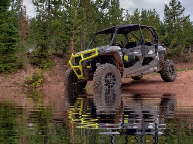 off-road vehicle parked near body of water