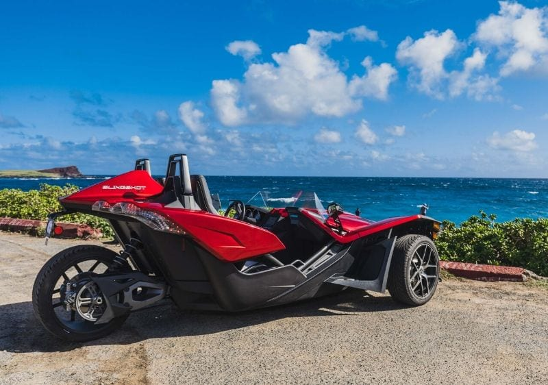 Polaris Slingshot parked along the scenic coast