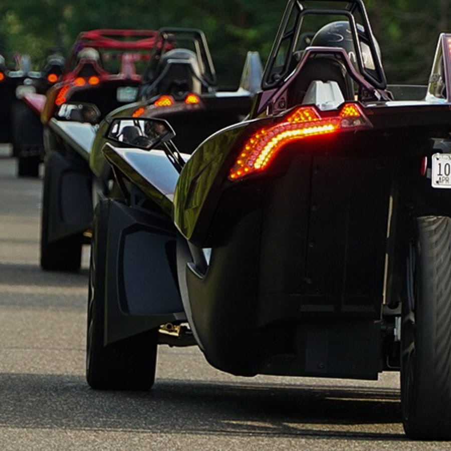 Polaris Slingshots lined up on road