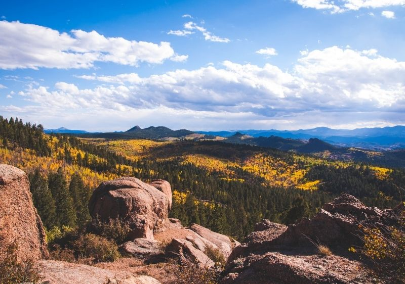 skyline of rocky mountains covered in fall colors