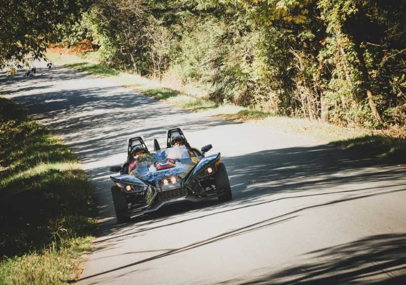 guests driving Polaris Slingshot