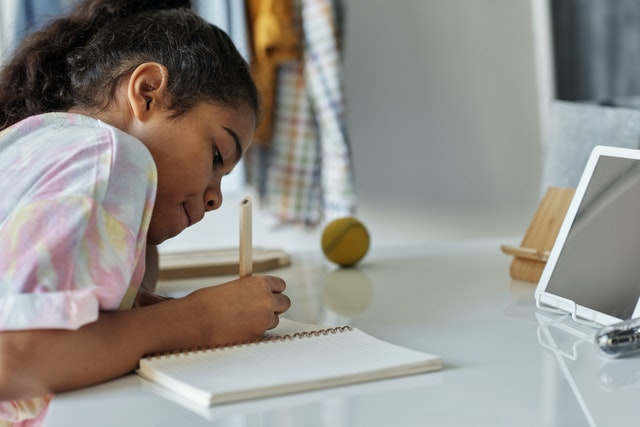 photo-of-girl-writing-on-white-paper-4143794.jpg