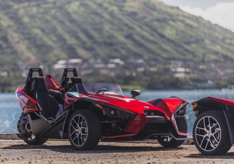 Polaris Slingshots parked at a coastal lookout