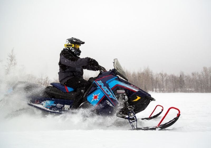 snowmobilers driving on open trails