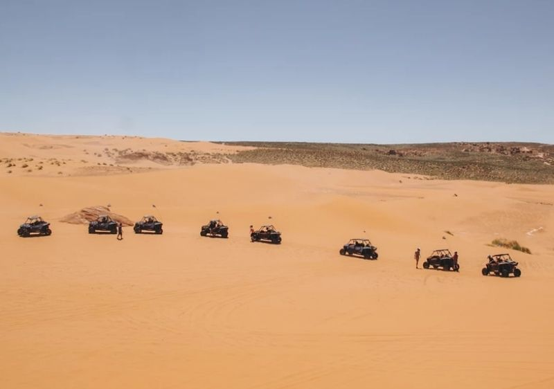 off-road vehicles parked in sandy desert