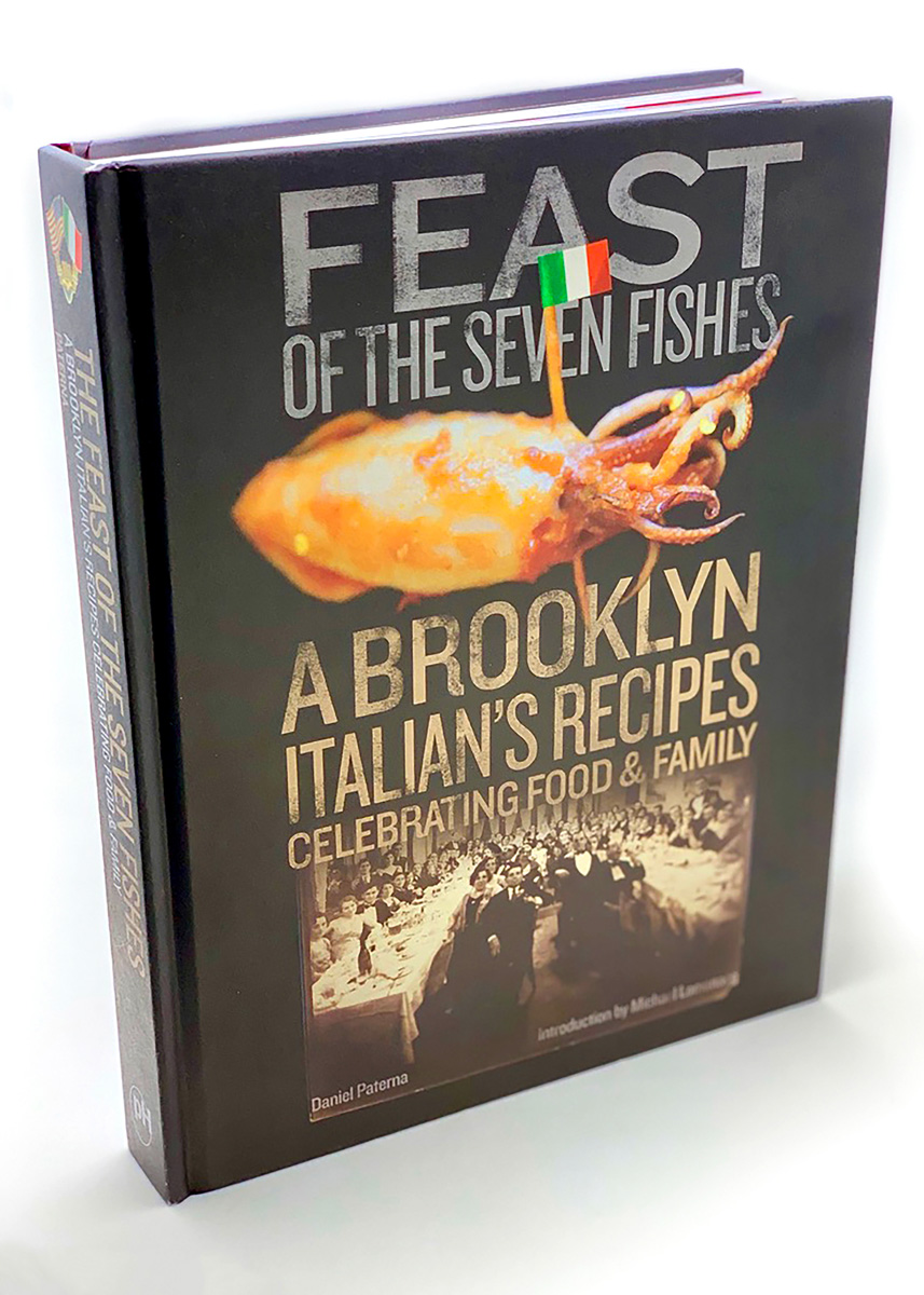 Book cover of Feast of the Seven Fishes depicting cooked squid pierced with Italian-flag-topped toothpick