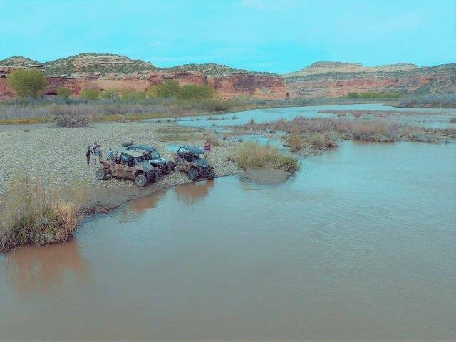 off-road vehicles parked in Rabbit Valley near body of water