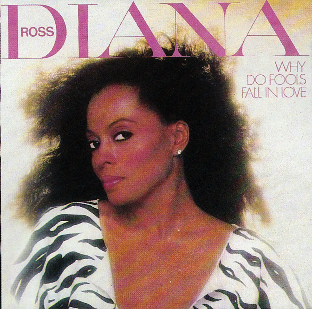 Record cover of Diana Ross's Why Do Fools Fall in Love, with the singer in a black-and-white blouse posed before glowing light