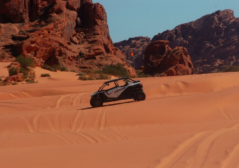 Polaris-RZR-driving-along-sand-dunes