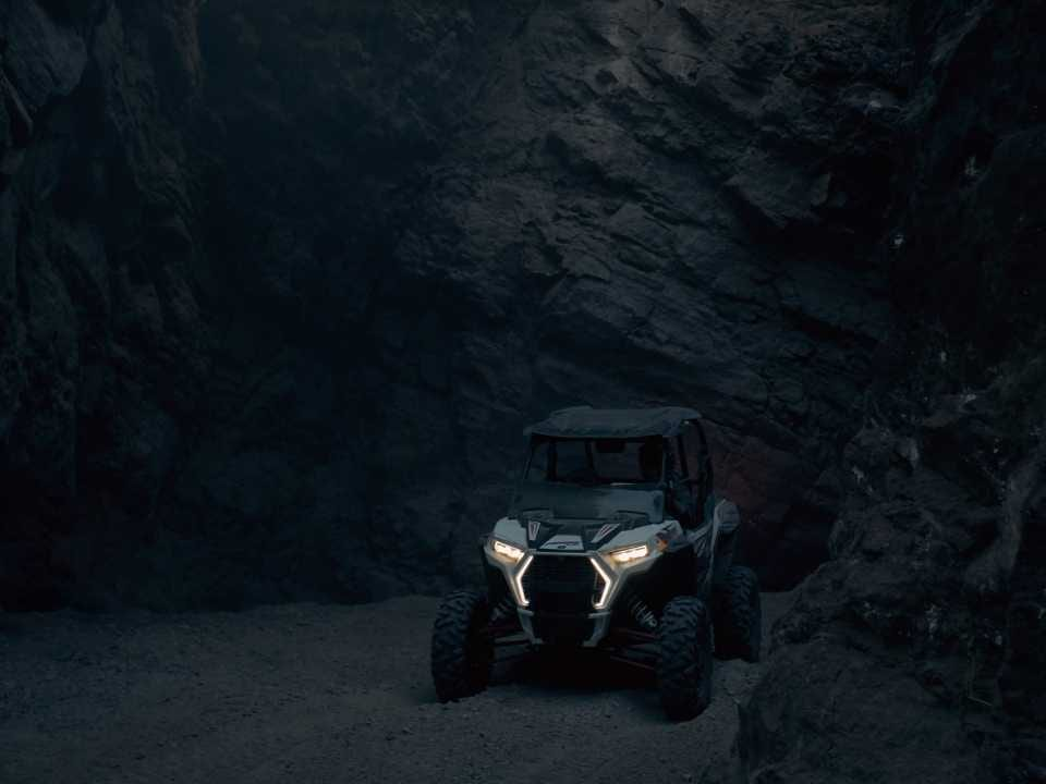 off-road vehicle parked in dark cave