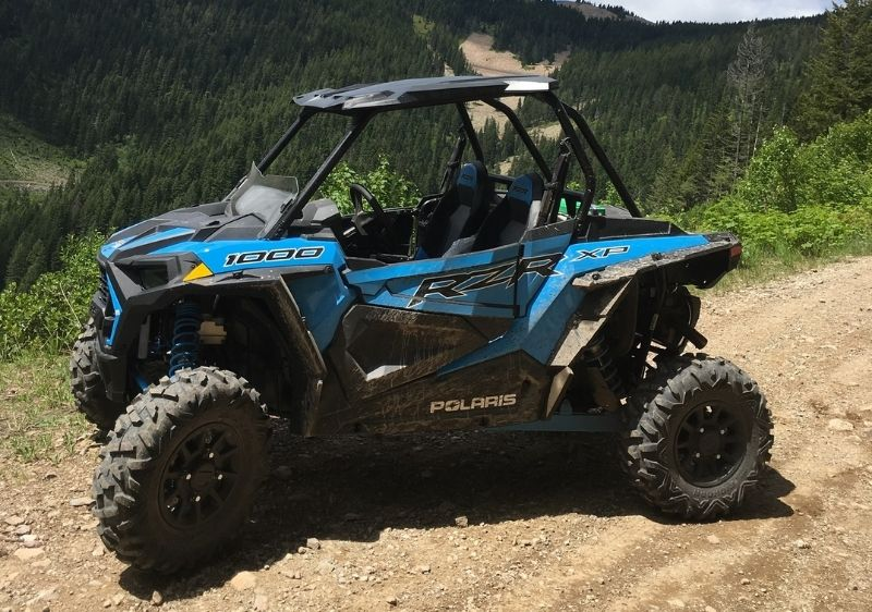 blue-Polaris-RZR-parked-along-a-scenic-overlook