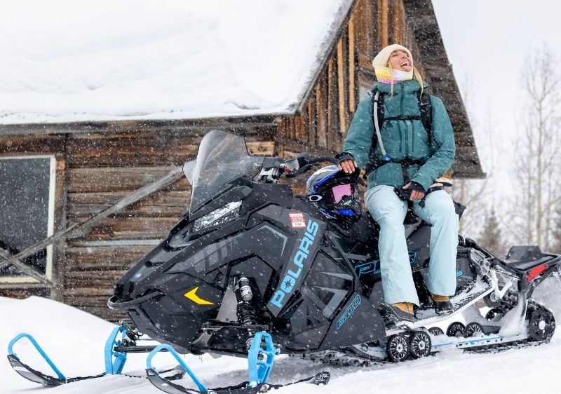 guest on snowmobile eating snowflakes