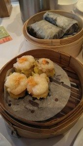 Eating Prawn Siu Mai and having a good time at teahouse with family.