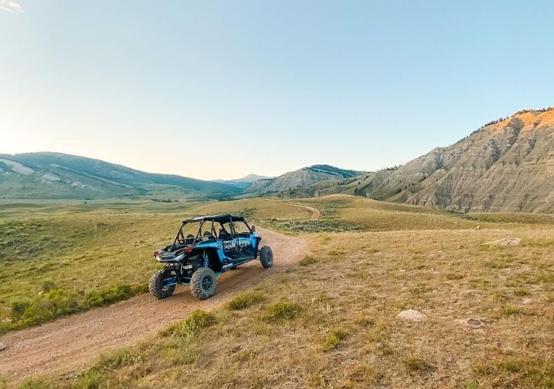 off-road vehicle driving through scenic mountain terrain