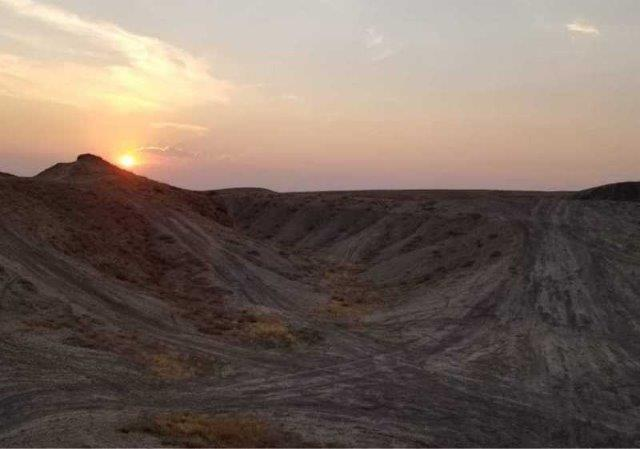 rocky sand mountains at sunset