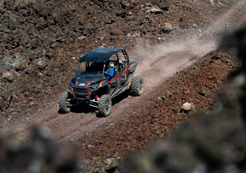 Polaris-RZR-driving-on-a-rocky-trail