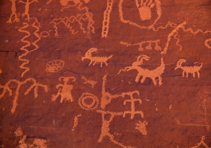 ancient-hieroglyphics-carved-in-red-rock