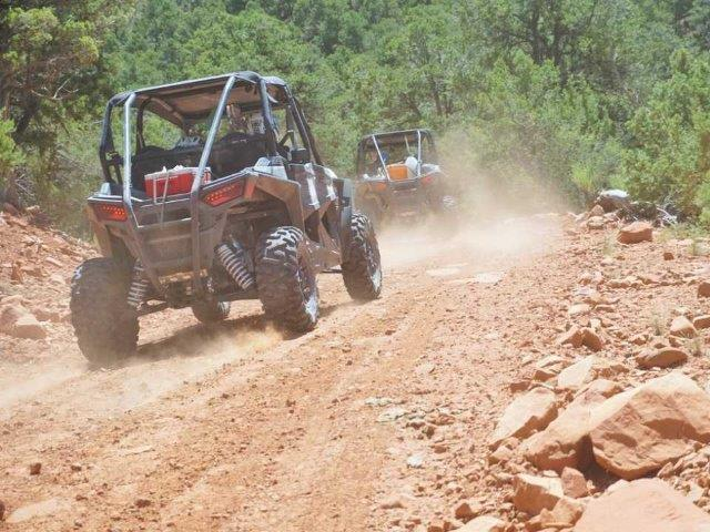 off-road vehicles driving on dirt trails