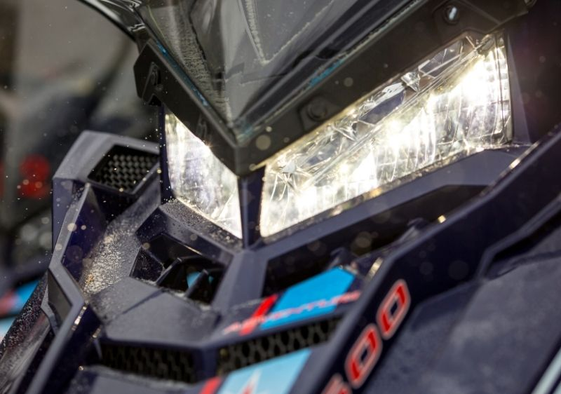 close up of snowmobile headlight