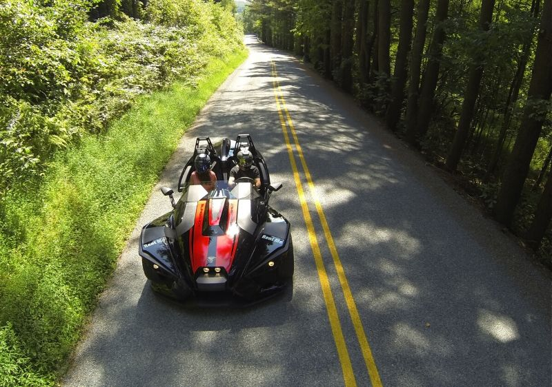 aerial-view-of-guests-in-a-Polaris-Slingshot-driving-through-a-wooded-area