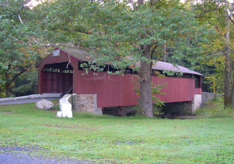 covered bridge with red shelter
