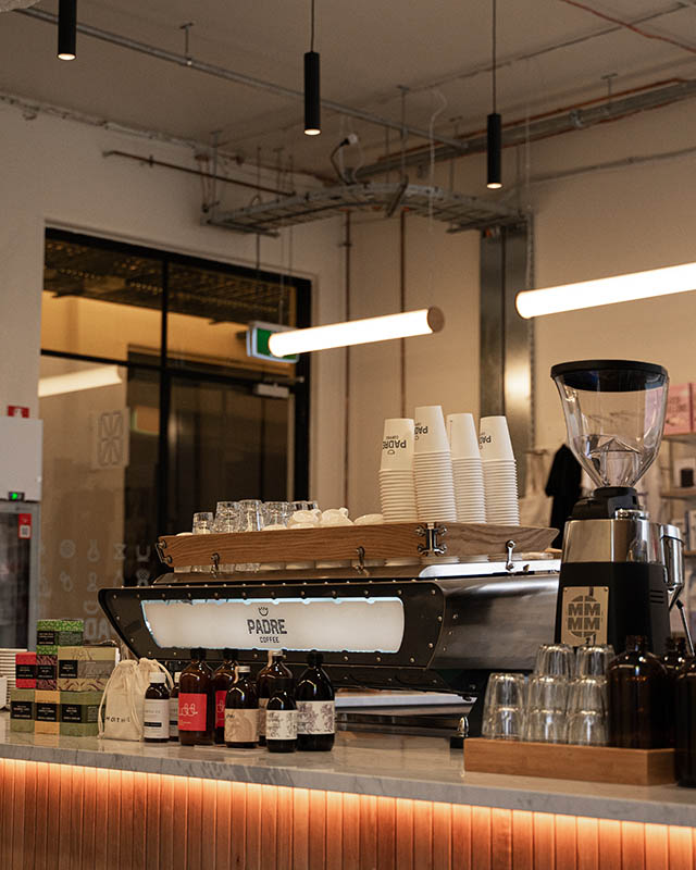 A barista station in an industrial looking space