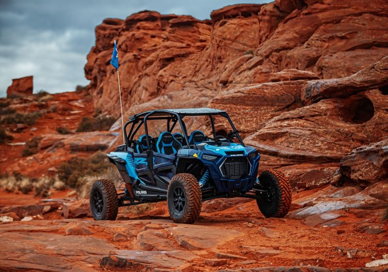 Polaris-RZR-parked-on-large-red-rock