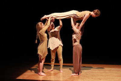 A dance piece performed by a group of students.
