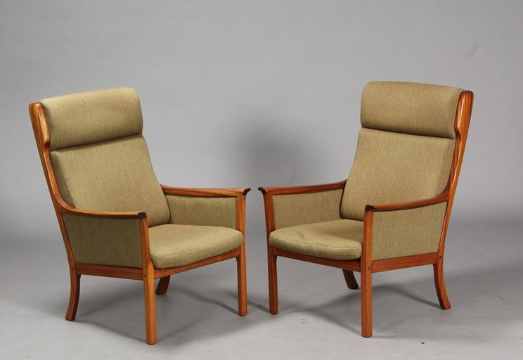 Pair of high-back mahogany armchairs and coffee table by Ole Wanscher for P. Jeppesen